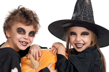 damn: Boy and girl wearing halloween costume with pumpkin on white background