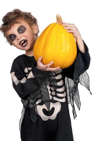 skeleton costume: Portrait of little boy wearing halloween costume with pumpkin on white background