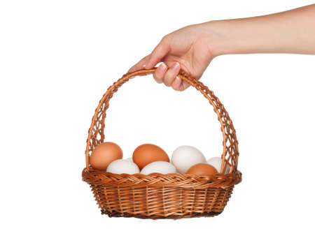 Basket with eggs in woman hand isolated on white background Stock Photo - 15334429