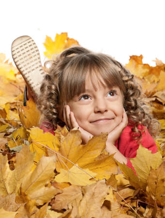 Portrait of a little girl with yellow foliage posing on white background Stock Photo - 15334602