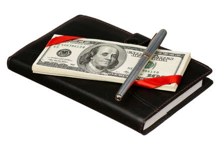 Heap of dollars and notepad isolated on a white background Stock Photo - 15334535