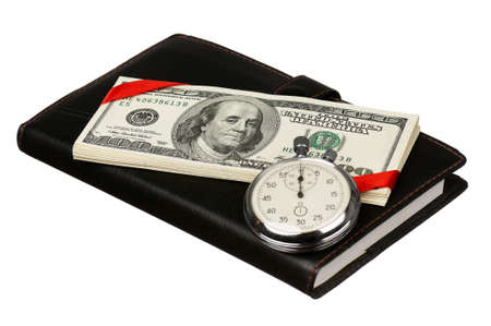 Heap of dollars with stopwatch and notepad isolated on a white background photo