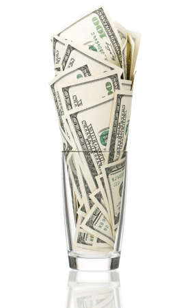 Glass with heap of dollars isolated on a white background Stock Photo - 15334458
