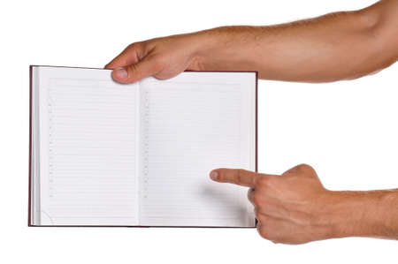 Man holding a exercise book isolated on white background Stock Photo - 15334510
