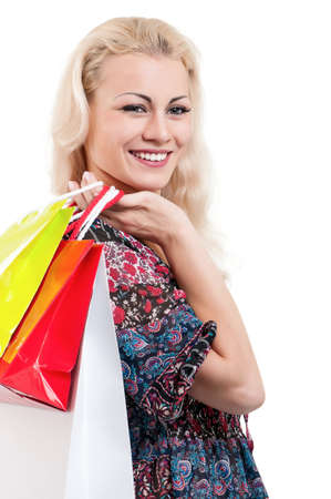 Portrait of a young woman holding a shopping bags over white background Stock Photo - 15334585
