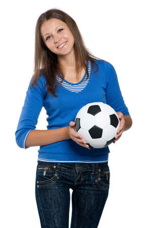 Beautiful teen girl with classic soccer ball posing on white background photo