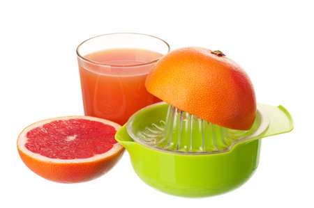Glass of fresh grapefruit juice, juicer and grapefruit fruits on white background Stock Photo - 15409045