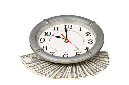 Heap of dollars with clock isolated on a white background photo
