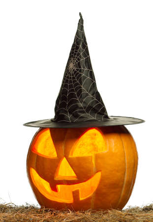 Funny Halloween pumpkin with black hat glowing on white background Stock Photo
