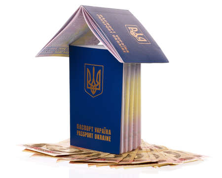 hryvna: Two international Ukrainian passport with Hryvna banknotes isolated on background