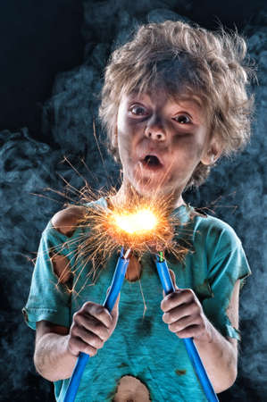 electrifying: Portrait of crazy little electrician over black background