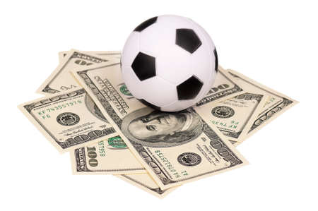 Small soccer ball on heap of dollars isolated on a white background photo
