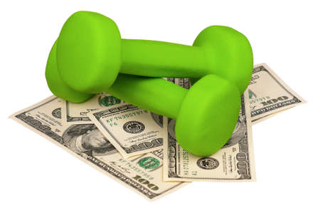 Dumbbells on heap of dollars isolated on a white background photo