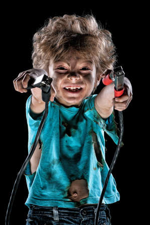 electrocute: Portrait of funny little electrician over black background
