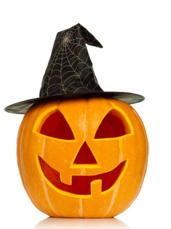 Funny Halloween pumpkin with black hat isolated on white background photo