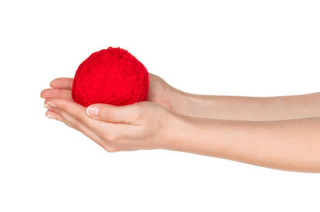 Woman hands with red ball of yarn for knitting isolated on white background photo