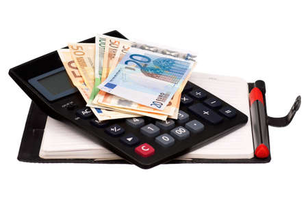 Heap of dollars and euro on notepad with calculator isolated on a white background photo
