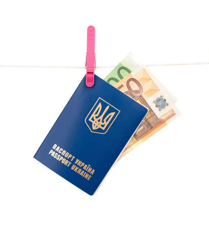 Clothes-peg holding international Ukrainian passport with Euro banknotes on a rope isolated on white background Stock Photo - 15550371