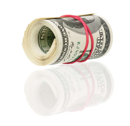 Roll of dollars with rubber band isolated on white background photo
