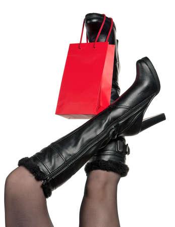 pantimedias: Detalle de la mujer de pie llevando botas negras de moda posando en blanco