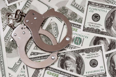 Handcuffs on money background as security concept Stock Photo - 15597824