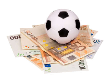 Small soccer ball on heap of euro isolated on a white background photo