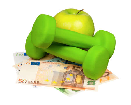 Dumbbells with apple on heap of euro isolated on a white background photo