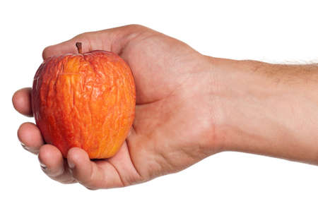 stale: Man hand with stale apple isolated on white background Stock Photo