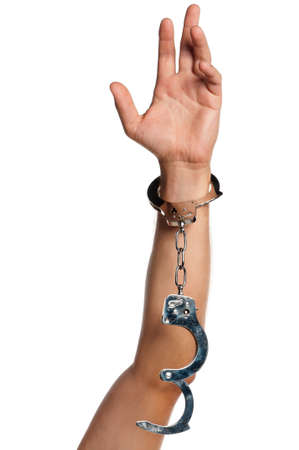 wristlets: Man hand with handcuffs isolated on white background