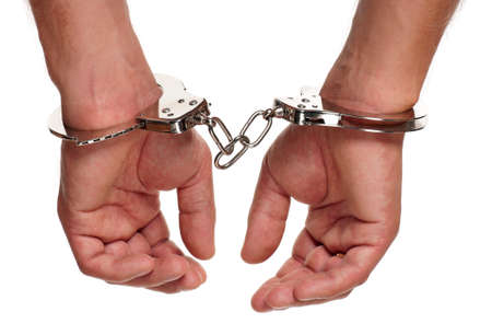 Man hands with handcuffs isolated on white background Stock Photo - 15597673
