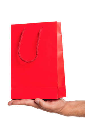 Man hand with red shopping bag isolated on white background photo
