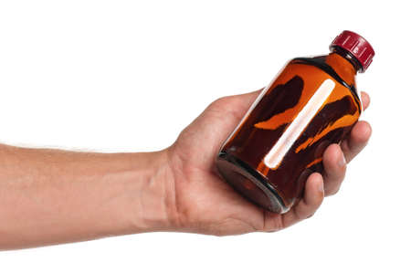 linctus: Man hand with small bottle isolated on white background Stock Photo