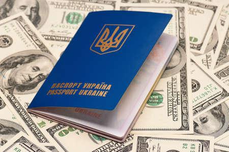 International Ukrainian passport on US dollars background Stock Photo - 15597812