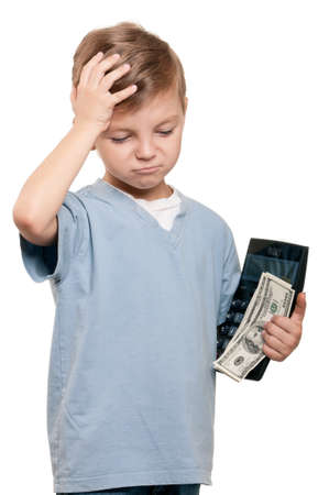 Portrait of a happy little boy with a calculator and dollars over white background Stock Photo