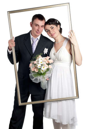 emotional couple: Portrait of happy bride and groom on white background