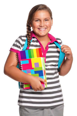 Happy girl with exercise books isolated on white background photo