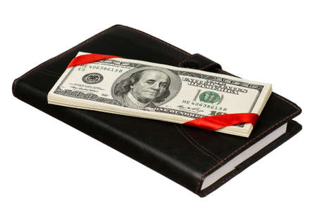 Heap of dollars and notepad isolated on a white background photo