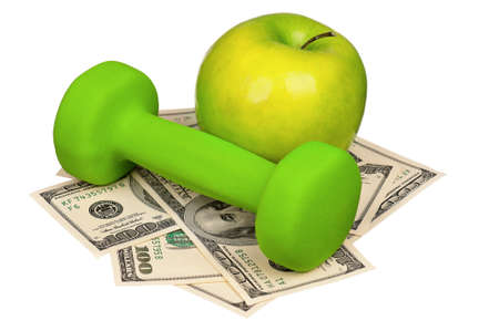 Dumbbells with apple on heap of dollars isolated on a white background photo