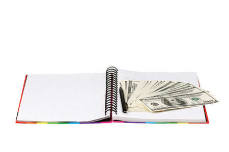 payoff: Heap of dollars and exercise book isolated on a white background