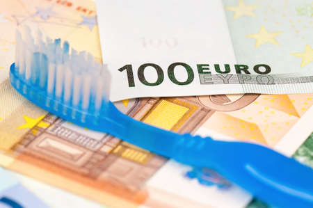 tidiness: Close-up of tooth brush on heap of euro Stock Photo