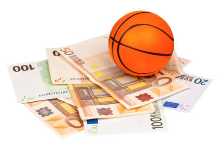 debt goals: Small basketball ball on heap of euro isolated on a white background Stock Photo