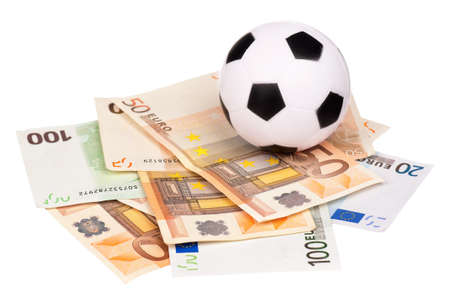 debt goals: Small soccer ball on heap of euro isolated on a white background