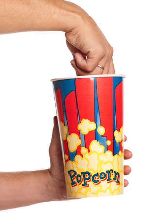 Man hands with popcorn isolated on white background photo