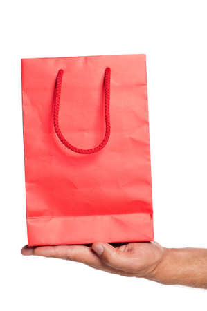 Man hand with red shopping bag isolated on white background Stock Photo - 15676414
