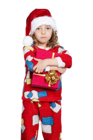 Portrait of happy Little girl in pajamas and santa hat with gift box over white background Stock Photo - 15775696