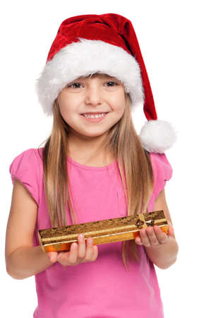 Portrait of happy little girl in santa hat with gift box over white background Stock Photo - 15775837