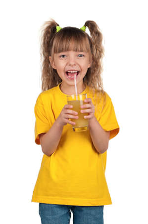 Portrait of happy little girl with glass of fresh juice with straw over white background photo