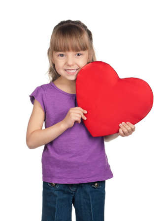 Portrait of little girl holding red heart over white background photo