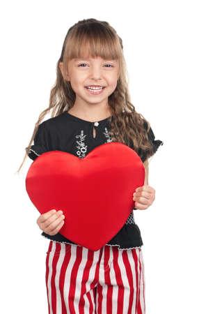 Portrait of little girl holding red heart over white background Banco de Imagens - 15775705