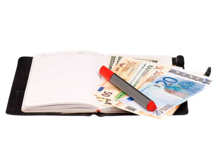 Heap of dollars and euro on notepad isolated on a white background photo
